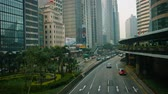 median : HONG KONG. CHINA - CIRCA JAN 2015: Overlooking shot of a busy. downtown commercial district of Hong Kong China. with modern buildings and impressive landscaping.
