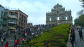 style : MACAU. CHINA - CIRCA JAN 2015: Many tourists strolling up and down the steps leading to the ruins of Sao Paulo Cathedral in Macau. China.