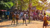 абориген : MON STATE. MYANMAR - CIRCA JAN 2014: Traditional burmese entertainment with music. dances and competition. Young men compete to reach a main prize on the top of slick bamboo pole. Стоковые видеозаписи