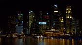 fullerton : SINGAPORE - CIRCA JAN 2015: Singapores night time cityscape with a range of contrasting architecture. UltraHD footage