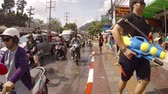 splashing : PATONG. PHUKET. THAILAND 13 APR 2016: Celebrants dancing and splashing in the streets at Songkran Festival in Patong. Thailand. 4k 2160p footage