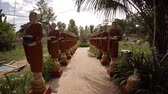 bo : Rows of sculptures portraying Buddhist monks Cambodia. UltraHD 4k footage Stok Video