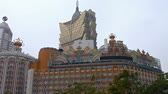 style : MACAU. CHINA - CIRCA JAN 2015: Unique and colorful face of Macaus Grand Lisboa Hotel and Casino Lisboa. FullHD 1080p video