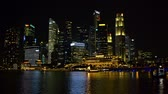 fullerton : SINGAPORE - CIRCA JAN 2015: Singapores dramatic. night time skyline over Marina Bay. Video FullHD 1080p