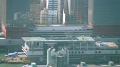 metropolitan : HONG KONG. CHINA - CIRCA JAN 2015: Commercial helicopter lifts off from a rooftop pad in downtown Hong Kong Stock Footage