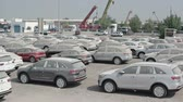 kia : SHARJAH. UAE - CIRCA OCT 2016: Lot Full of Brand New Cars. Recently Arrived in Shipping for Local Delivery