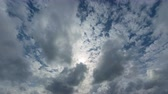 слои : Abstract clip shows puffy. white clouds. drifting across the blue sky in two layers. in timeslapse.