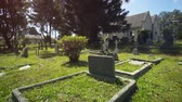 кресты : Ancient cemetery near Holy Trinity Church is an Anglican church in Nuwara Eliya in Sri Lanka. Stock footage 4k