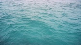 outing : The surface of the ocean water near the pier. Maldives. Video FullHD 1080p Stock Footage