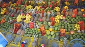 mangos : Variety of colorful fruits on display. for sale as religious offerings outside a temple in Kataragama. Sri Lanka.