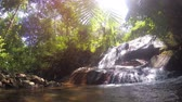 şelaleler : A hot sunny day in the rain forest of Thailand near the waterfall. 4k video