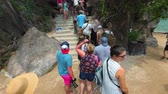 tapu : PHANG-NGA. THAILAND - APR 2018: Tourists ascend concrete steps in the limestone formations on James Bond Island.