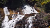 inthanon : Closeup view of water tumbling down the rocky face of Siribhume Waterfall. at Doi Inthanon National Park in Thailand. with sound.
