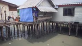 palafitte : Simple houses. constructed on wooden piers over the sea. at a poor fishing village on the coast of Southern Thailand. 4k footage