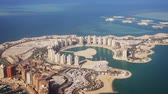 жемчуг : Passenger window view of Pearl Qatar. an artificial island. with its modern. highrise architecture. from a commercial airliner. FullHD footage