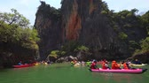 phangnga : PHANG-NGA. THAILAND - APR 2018: Kayaking excursion at a remote. tropical island in southern Thailand. 4k stock footage