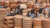GEORGIA - OCT 2018: Interesting variety of decorative. terra cotta containers and cookware. displayed for sale at a public market in the Republic of Georgia. 6k video