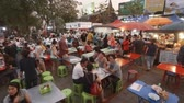 CHIANG MAI. THAILAND JAN 2018: Crowd of Customers at an Outdoor Dining Area of a Local Street Food Market. Ultra HD 4k video