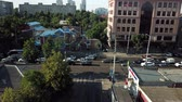 road top view : Abstract aerial drone footage of rooftops and streets in the center of Krasnodar city, Russia. Traffic congestion rush hour.
