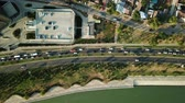 russian : Aerial Drone Flight View of freeway busy city rush hour heavy traffic jam highway, .  Aerial view of the vehicular intersection,  traffic at peak hour with cars on the road and on the bridge.