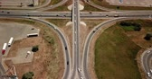 автомагистраль : Summer aerial footage of transport junction, traffic cross road junction day view from above with circle road. Top down view of traffic jam.