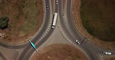 джем : Summer aerial footage of transport junction, traffic cross road junction day view from above with circle road. Top down view of traffic jam.