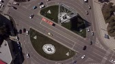 Top view zoom out urban road with traffic cars, top down view of roundabout Stok Video