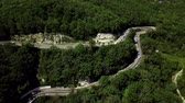 enrolamento : Aerial view of a curved winding road trough the mountains Stock Footage