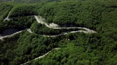 Drone view of a curved winding road trough the mountains