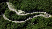 Fly over curved winding road trough the mountains