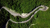 Aerial view of a curved winding road trough the mountains Vidéos Libres De Droits