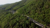 Aerial top down view: of cars driving on zig zag winding mountain road