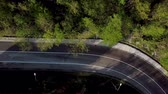 Top down view of winding mountain road with cars Stok Video