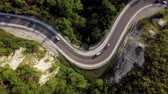 サーペンタイン : Top down view of winding mountain road with cars 動画素材