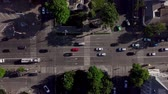 otoyol : Drones Eye View - Aerial view of the vehicular intersection, fly under trees. Stok Video