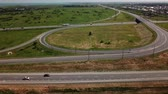 ring road : Aerial view of modern highway road intersection with traffic circle on rural landscape Stock Footage