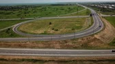 ring road : 4K aerial fly over modern highway road intersection on rural landscape