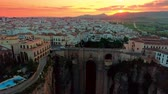 iberico : Ronda aerial view with historical bridge and city skyline at sunrise in Spain.