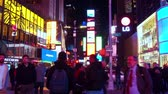 vezes : NEW YORK CITY, USA - OCT 30, 2018: Times Square at night with tourists  in midtown Manhattan New York City.