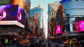 sugárút : NEW YORK CITY, USA - OCT 30, 2018: Walk across with busy 42nd street view in Midtown Manhattan with pedestrian and traffic. Stock mozgókép