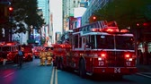 wypadek : NEW YORK CITY, USA - OCT 30, 2018: Fire truck and police car ambulance at 42nd street in response to an emergency incident in Midtown Manhattan.