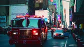 policista : NEW YORK CITY, USA - OCT 30, 2018: Fire truck and police car ambulance at 42nd street in response to an emergency incident in Midtown Manhattan.