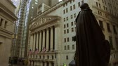 NEW YORK CITY, USA - OCT 30, 2018: Wall Street panorama with skyscrapers and Washington Statue as the famous financial district in downtown Manhattan.
