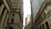 NEW YORK CITY, USA - OCT 30, 2018: A panoramic view of Wall Street with skyscrapers as the famous financial district in downtown Manhattan.
