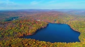 sete : Aerial view of lake in Autumn with colorful foliage Stock Footage