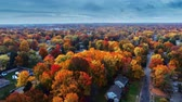 yerleşim : Aerial view of residential area in Autumn with colorful foliage Stok Video