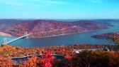 Aerial view of Hudson River and Bear Mountain Bridge in New York State in Autumn with colorful foliage.