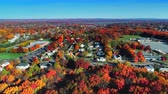 new house : Aerial view of residential area in Autumn with colorful foliage Stock Footage