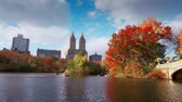 usa : New York City Central Park in Autumn with skyscrapers apartment boat and lake