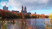 usa : Walking view in New York City Central Park in Autumn with skyscrapers apartment boat and lake